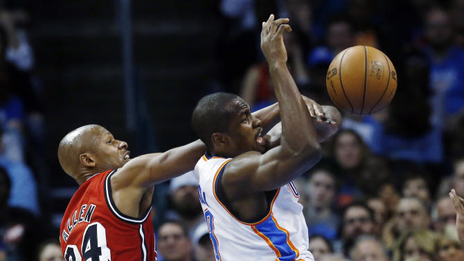 Miami Heat guard Ray Allen, left, knocks the ball away from Oklahoma City Thunder forward Serge Ibaka (9) in the second quarter of an NBA basketball game in Oklahoma City, Thursday, Feb. 14, 2013. (AP Photo/Sue Ogrocki)