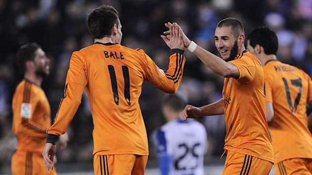 Real Madrid's forward Karim Benzema (R) celebrates his opener against Espanyol (AFP)