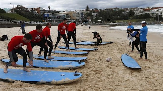 DATE IMPORTED:June 15, 2013British and Irish Lions rugby players attend a surfing lesson at Bondi beach in Sydney (Reuters)