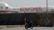 "Kingfisher Airlines aircraft are seen parked inside the perimeter wall of the at the Chatrapati Shivaji International Airport in Mumbai. India's cash-strapped Kingfisher Airlines declared a ""partial lock-out"" on Monday, suspending flights for three days following alleged criminal intimidation and violence by striking employees"