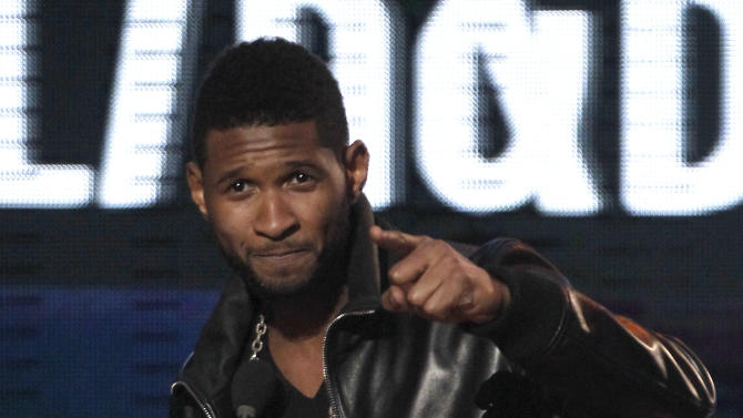 Usher accepts the award for soul R&B favorite male artist at the 38th Annual American Music Awards on Sunday, Nov. 21, 2010 in Los Angeles. (AP Photo/Matt Sayles)