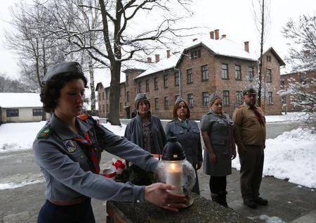 Last survivors recall Auschwitz, ask if lessons learned