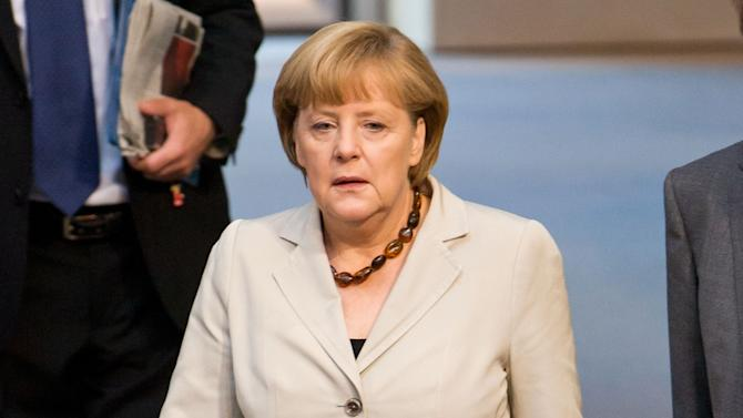 GermanChancellor Angela Merkel arrives for her government statement on the recent G8 and the upcomingEU Summit at the German parliament, the Bundestag, in Berlin,Germany, Thursday June 27, 2013. (AP Photo/dpa,Tim Brakemeier)