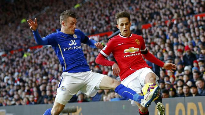 Manchester United's Adnan Januzaj is challenged by Leicester City's Jamie Vardy during their English Premier League soccer match at Old Trafford in Manchester