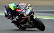Spanish rider Pol Espargaro corners his Pons 40 HP Tuenti bike during the Moto2 race of the British Grand Prix at the Silverstone racetrack near Northampton. Espargaro, on a Kalex, won the British Moto2 Grand Prix, beating home hope and teammate Scott Redding
