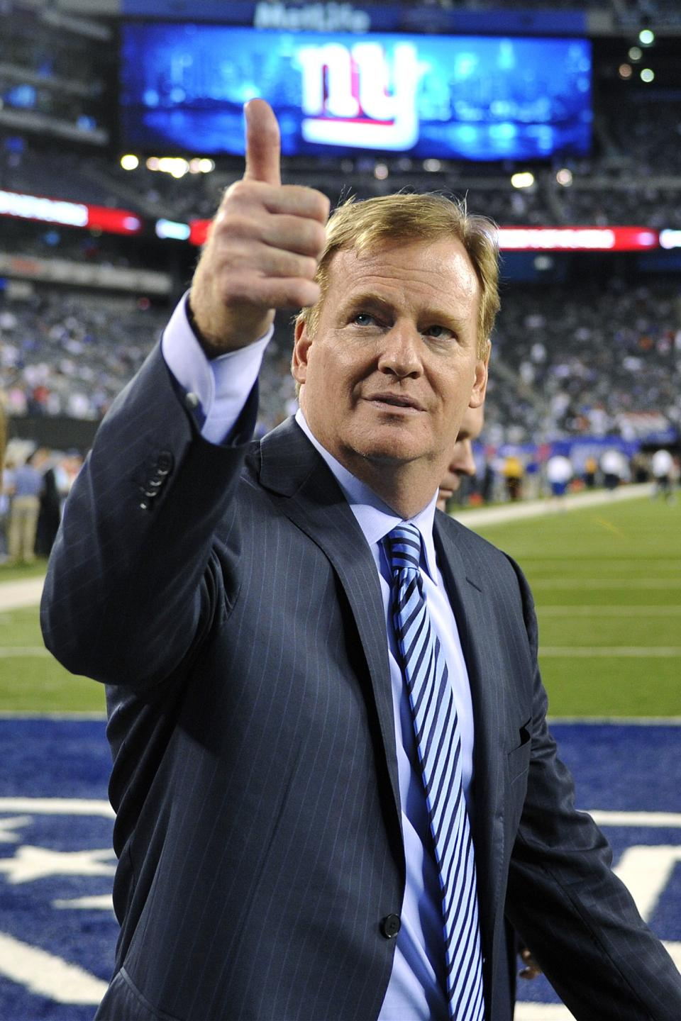 Commissioner Roger Goodell gestures to fans before an NFL football game between the New York Giants and the Dallas Cowboys, Wednesday, Sept. 5, 2012, in East Rutherford, N.J. (AP Photo/Bill Kostroun)