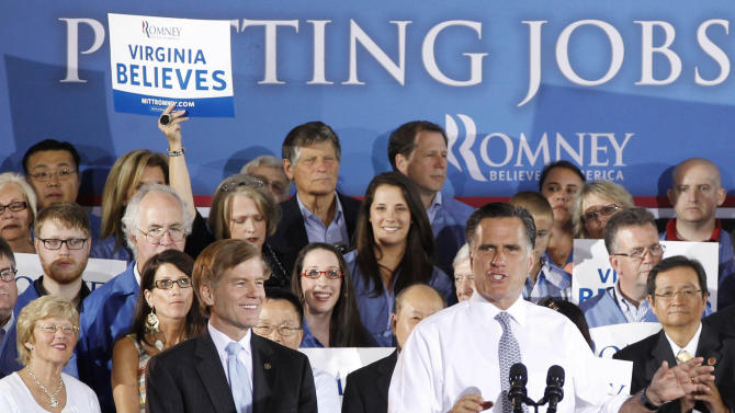 "FILE - In this June 27, 2012, file photo Republican presidential candidate Mitt Romney speaks at a ""Putting Jobs First"" campaign rally in Sterling, Va., with Virginia Gov. Bob McDonnell, center left. When you vote in November 2012, you'll be voting for more than a president; you'll be casting a ballot for and against a checklist of policies that touch your life and shape the country you live in. It can be hard to see through the process that the election is a contest of actual ideas, but it is always so. A candidate's words connect to deeds in office. (AP Photo/Charles Dharapak, File)"
