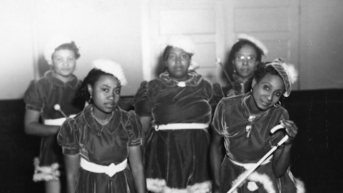"This 1942 photo provided by the Louisiana State Museum shows Gold Digger Baby Dolls, one of the neighborhood groups that adopted the ""baby doll"" costumes. The costumes first became part of New Orleans' Mardi Gras in 1912 with a group of black prostitutes, but spread within decades into the city's respectable African-American neighborhoods. The tradition is enjoying a modern resurgence. (AP Photo/State Library of Louisiana, Collection of the U.S. Works Progress Administration of Louisiana)"
