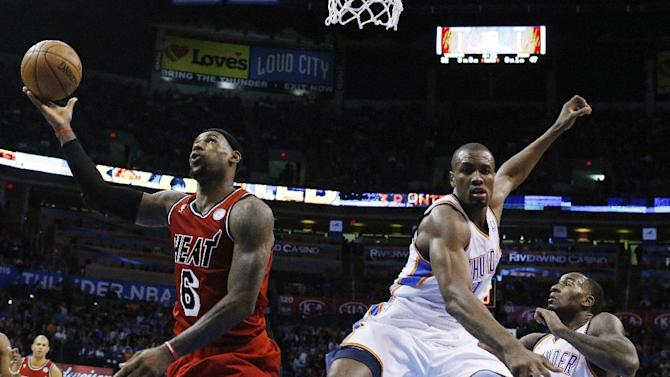 Miami Heat forward LeBron James (6) completes his shot after a foul by Oklahoma City Thunder forward Serge Ibaka (9) in the second quarter of an NBA basketball game in Oklahoma City, Thursday, Feb. 14, 2013. (AP Photo/Sue Ogrocki)