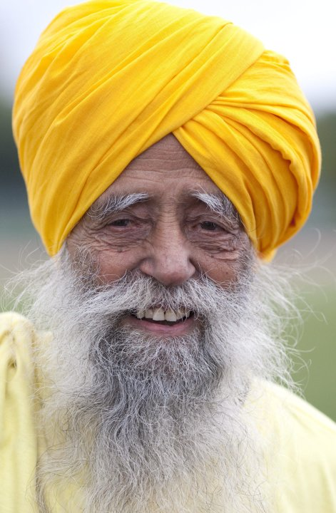 Centenarian Fauja Singh smiles on the track between races in Toronto, Thursday Oct. 13, 2011. One-hundred-year-old Singh, originally from India now living in London,  England,  is competing in Toronto