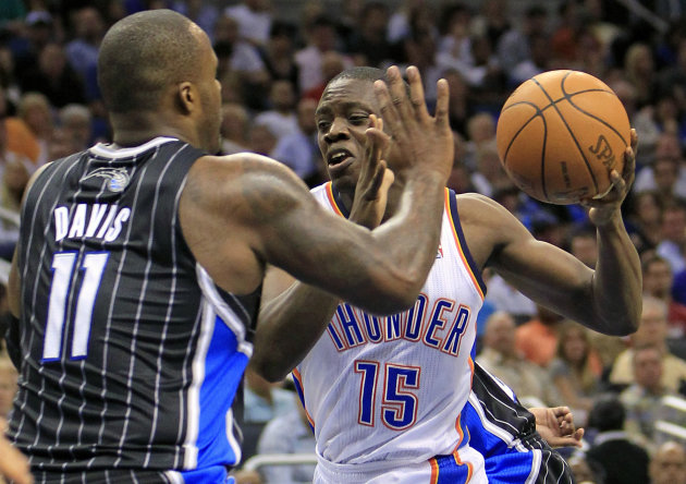 Oklahoma City Thunder's Reggie Jackson (15) looks for room around Orlando Magic's Glen Davis (11) during the first half of an NBA basketball game Thursday, March 1, 2012, in Orlando, Fla. (AP Photo/Jo