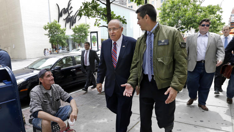 Gabriel Gomez, right center, the Republican candidate for U.S. Senate in the Massachusetts open seat special election, walks with former New York City Mayor Rudy Giuliani to greet potential voters during a walk on Boylston Street in Boston, Thursday, June 6, 2013. (AP Photo/Elise Amendola)
