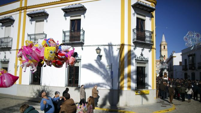 A man sells balloons during the annual San Antonio Abad festival in Trigueros