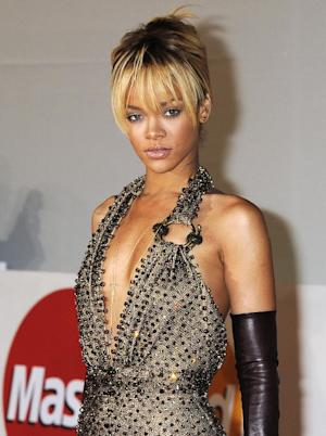 """FILE - In this Feb. 21, 2012 file photo, performer Rihanna arrives for the Brit Awards 2012 at the O2 Arena in London. Rihanna says her collaboration with former boyfriend Chris Brown made sense. Brown appears on a remix to her song """"Birthday Cake"""" and she appears on a remix to his """"Turn Up The Music."""" Their music union is noteworthy because Brown beat Rihanna up three years ago and is still on probation for the assault. She says the partnership allowed their fans to come together and says """"there shouldn't be a divide. ... It's music, and it's innocent."""" She made the comments to Ryan Seacrest on his radio show on KIIS-FM in Los Angeles. (AP Photo/Jonathan Short, file)"""