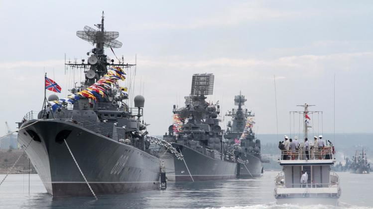 Russian warships are seen during a naval parade rehearsal in the Crimean port of Sevastopol