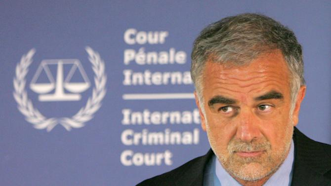 """File -- IN a Feb. 27, 2007 file photo the International Criminal Court's prosecutor Luis Moreno-Ocampo reacts during a press conference in The Hague, Netherlands.  In a briefing to the Security Council on Nov. 2, 2011, about Nato in Libya, Moreno-Ocampo said """"there are allegations of crimes committed by NATO forces (and) these allegations will be examined impartially and independently.""""   (AP Photo/Peter Dejong/file)"""