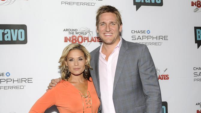 """Hosts Cat Cora, left, and Curtis Stone attend the """"Around the World in 80 Plates"""" Finale Sneak Peek Party presented by Chase Sapphire Preferred and Bravo on Thursday, July 12, 2012 in New York, NY.  (Photo by Evan Agostini/Invision for Chase Sapphire Preferred/AP Images)"""
