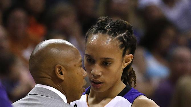 Phoenix Mercury's Brittney Griner, right, talks with head coach Corey Gaines as she comes out of the game in the first half during a WNBA basketball game against the Chicago Sky on Monday, May 27, 2013, in Phoenix. (AP Photo/Ross D. Franklin)