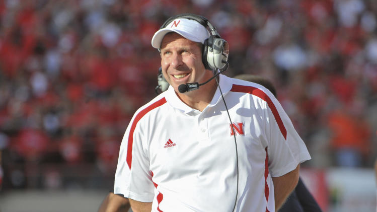 Nebraska head coach Bo Pelini looks at the scoreboard in the first half of an NCAA college football game against Penn State in Lincoln, Neb., Saturday, Nov. 10, 2012. (AP Photo/Dave Weaver)