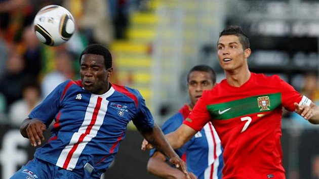 Cape Verde&#39;s Varela (L) heads the ball next to Portugal&#39;s Cristiano Ronaldo during their friendly