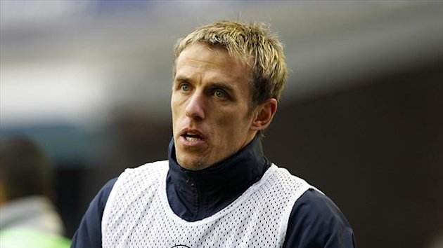 Phil Neville helped coach England's Under-21s this summer
