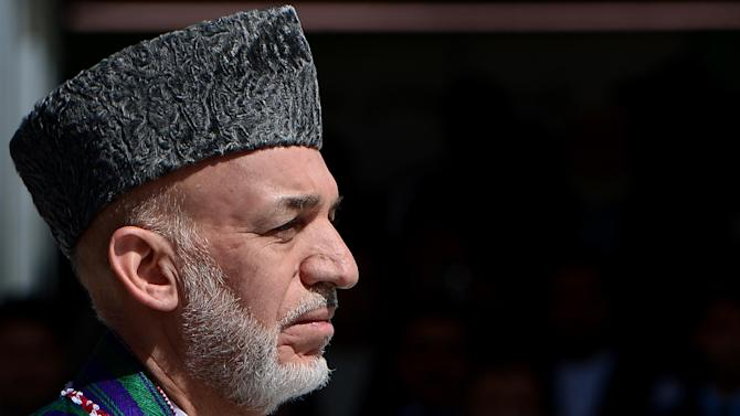 Afghan President Hamid Karzai pictured during an event to mark Independence Day at the Ministry of Defence compound in Kabul on August 19, 2014
