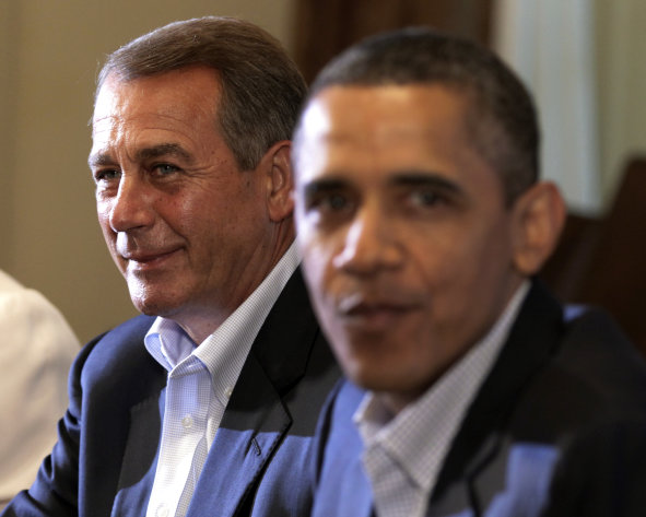 House Speaker John Boehner of Ohio, left, and President Barack Obama meet with congressional leaders in the Cabinet Room of the White House,Sunday, July 10, 2011, in Washington, to discuss the debt. (AP Photo/Carolyn Kaster)