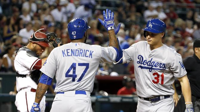 Los Angeles Dodgers' Joc Pederson (31) celebrates his home run with Howie Kendrick (47) as Arizona Diamondbacks' Welington Castillo, left, puts his catcher's mask back on during the fourth inning of a baseball game Monday, June 29, 2015, in Phoenix. (AP Photo/Ross D. Franklin)
