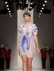 A model wears a design from the Antoni and Alison Spring/Summer 2013 collection during London Fashion Week, Friday, Sept. 14, 2012. (AP Photo/Joel Ryan)