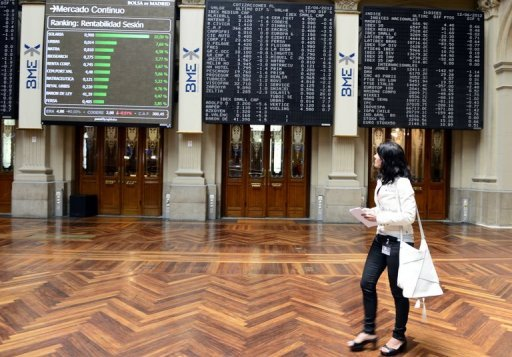 <p>A woman walks in front of prices boards at the Bolsa de Madrid. European shares rallied on Tuesday and the euro pulled away from a two-year dollar low, as investors cautiously approved a eurozone deal to help Spain, and shrugged off weak Chinese data.</p>
