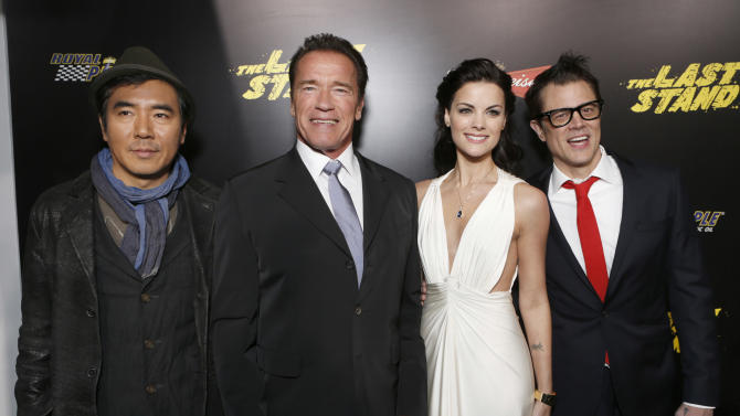 "Director Jee-woon Kim, Arnold Schwarzenegger, Jaime Alexander and Johnny Knoxville attend the LA premiere of ""The Last Stand"" at Grauman's Chinese Theatre on Monday, Jan. 14, 2013, in Los Angeles. (Photo by Todd Williamson/Invision/AP)"