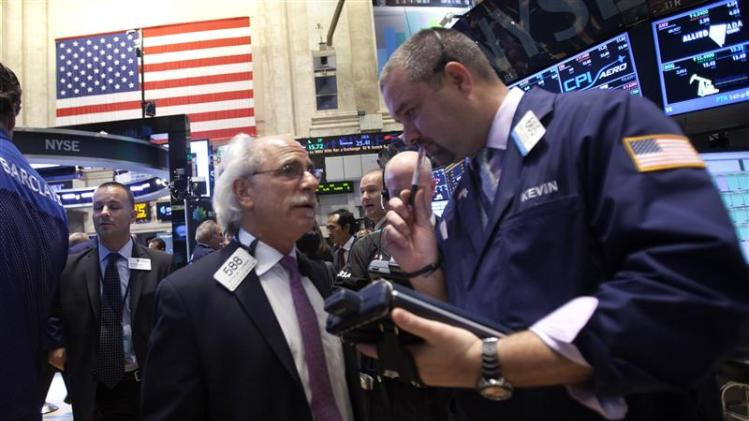 Traders speak on the floor of the New York Stock Exchange at the market open in New York