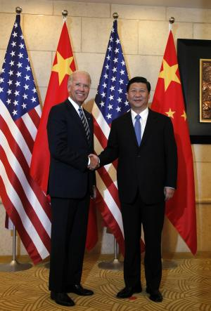 U.S. Vice President Joe Biden, left, poses for photos with Chinese Vice President Xi Jinping before their talks at a hotel in Beijing, China, Friday, Aug. 19, 2011. (AP Photo/Ng Han Guan, Pool)