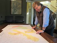 Teddy Turner, son of media magnate Ted Turner, looks over a map of South Carolina&#39;s 1st Congressional District in his home in Mount Pleasant, S.C., on Tuesday, Jan. 22, 2012. Turner is now one of at least 10 Republicans and two Democrats seeking former U.S. Rep. Tim Scotts old seat in a district reaching from the sea islands northeast of Charleston southwest to the gated communities on the resort of Hilton Head Island. (AP Photo/Bruce Smith)