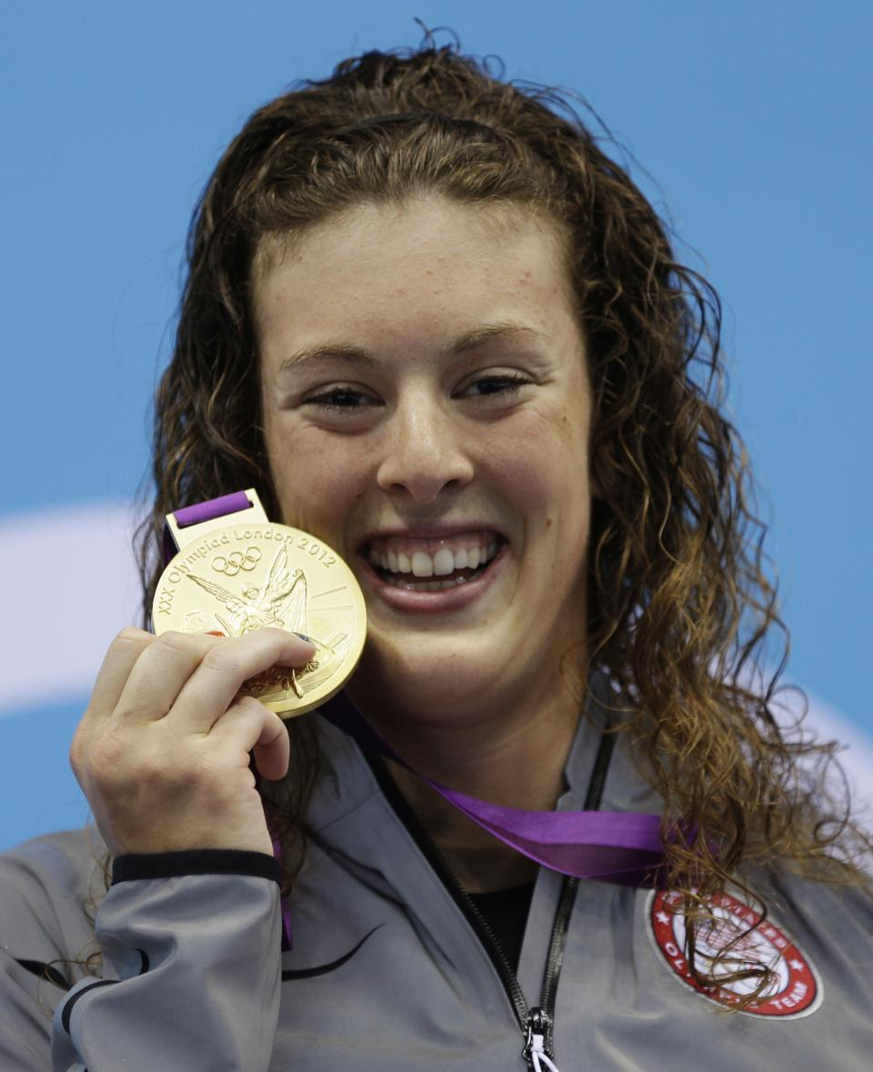 United States' Allison Schmitt poses with her gold medal for the women's 200-meter freestyle swimming final at the Aquatics Centre in the Olympic Park during the 2012 Summer Olympics in London, Tuesday, July 31, 2012. (AP Photo/Michael Sohn)