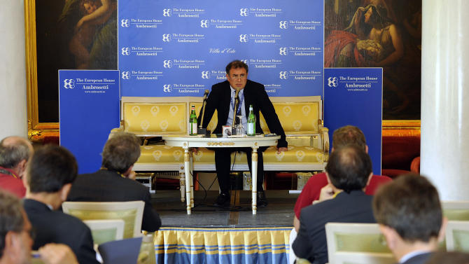 U.S. economist Nouriel Roubini, center, speaks during a meeting on the world economy in Cernobbio, Italy, Friday, Sept. 7, 2012. Experts and leaders gathered in Italy to discuss the global financial crisis. (AP Photo/Giuseppe Aresu)
