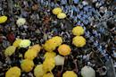 "In this photo taken Monday, Sept. 28, 2015, protesters holding yellow umbrellas gather to observe a moment of silence to mark the first anniversary of ""Umbrella Movement"" outside the government headquarters in Hong Kong. A year ago, Hong Kong's famously busy streets were shut down by pro-democracy activists who occupied them for 79 days in what became known as the ""Umbrella Movement."" The protests were led by students and other activists who took to the streets to voice their opposition against Beijing's plan to restrict elections for top leader of the semiautonomous Chinese city. (AP Photo/Kin Cheung)"