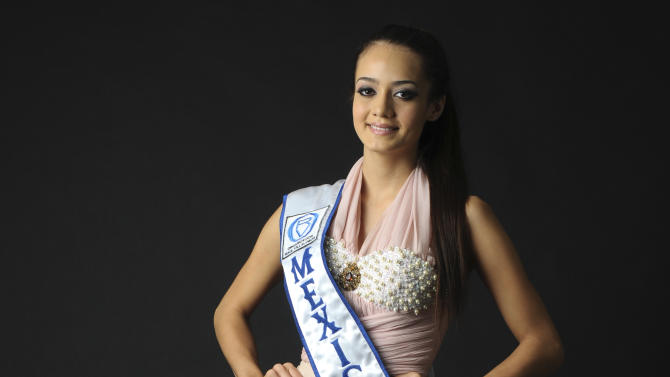 In this April 26, 2012 photo, Maria Susana Flores Gamez poses for a photo for a story about her upcoming participation in a beauty pageant in China, in Culiacan, Mexico.  Flores, who was voted the 2012 Woman of Sinaloa in a beauty pageant in February, was killed in northern Mexico on Nov. 24, 2012 during a running gun battle between soldiers and the gang of drug traffickers she was traveling with. (AP Photo/El Debate, Gladys Serrano)