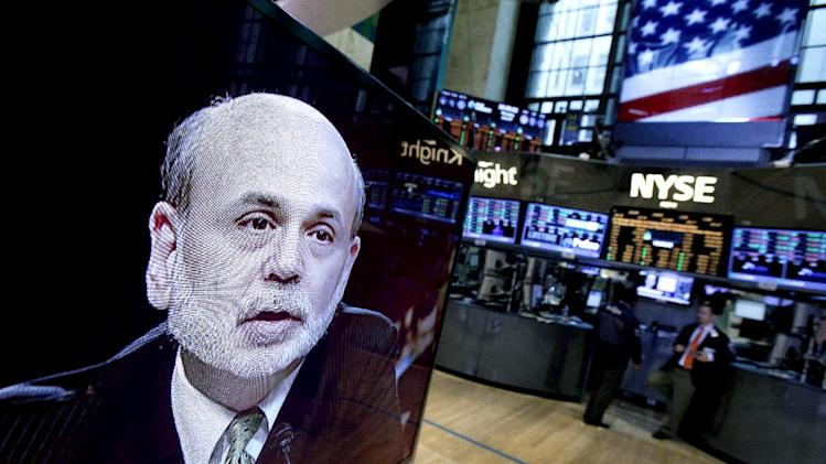 FILE-In this Thursday, June 7, 2012, file photo, Federal Reserve Chairman Ben Bernanke appears on a television screen on the floor of the New York Stock Exchange. Americans' wealth dipped about 0.5 percent in the April-June quarter as a drop in stock prices more than offset a gain in home values. Yet since June, a resurgent stock market has jumped about 7 percent; more than reversing last quarter's 3 percent drop in stock prices. (AP Photo/Richard Drew, File)