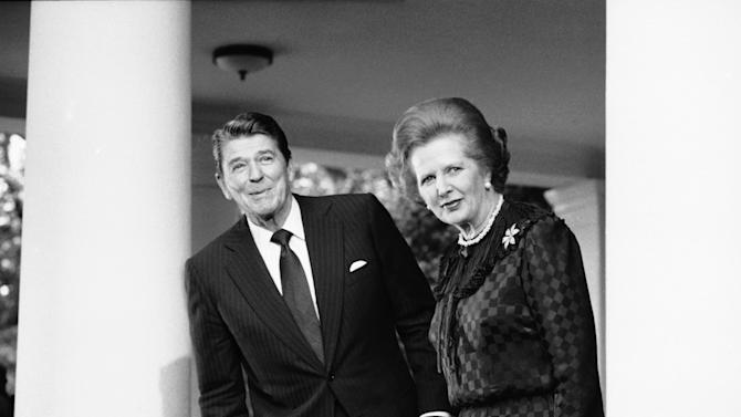 "FILE - In this June 23, 1982 file photo, President Ronald Reagan and British Prime Minister Margaret Thatcher speak to reporters at the White House in Washington.  Ex-spokesman Tim Bell says that Thatcher has died. She was 87. Bell said the woman known to friends and foes as ""the Iron Lady"" passed away Monday morning, April 8, 2013. (AP Photo/File)"