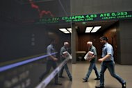 &lt;p&gt;Employees pass an electronic display at the Athens stock exchange. Despite making progress, the eurozone debt crisis remains unsolved and, in a repeat of last summer, could still bring nasty surprises to global stock markets in July and August, analysts said&lt;/p&gt;