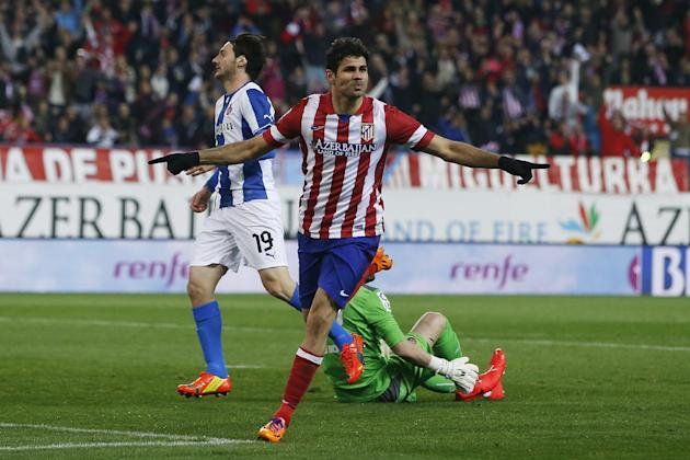 Atletico's Diego Costa, center, celebrates his goal during a Spanish La Liga soccer match between Atletico Madrid and Espanyol at the Vicente Calderon stadium in Madrid, Spain, Saturday, March 15,