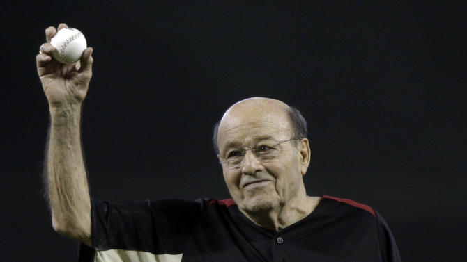 Joe Garagiola gets ready to throw a ceremonial first pitch before the MLB All-Star baseball game Tuesday, July 12, 2011, in Phoenix. (AP Photo/David J. Phillip)