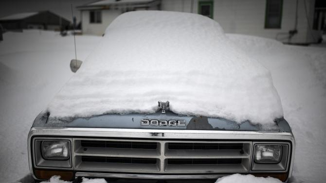 A Dodge truck is seen under snow following a massive snowstorm in Cowlesville