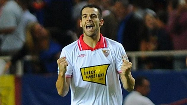 Sevilla forward Alvaro Negredo celebrates after scoring at the Ramon Sanchez Pizjuan (AFP)