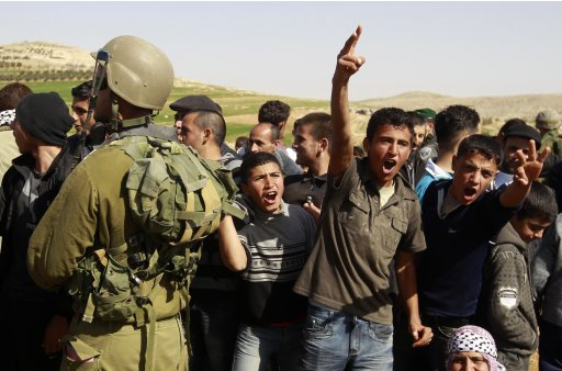 Palestinians attend a protest after the Israeli army banned them from setting up a encampment in the West Bank village of Al-Tiwaneh south of the West Bank town of Hebron