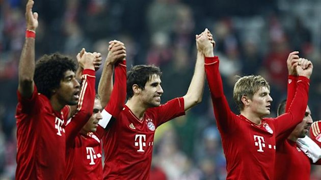 Bayern Munich's Dante (L-R), Philipp Lahm, Javi Martinez, Toni Kroos and Franck Ribery celebrate their victory after their German first division Bundesliga