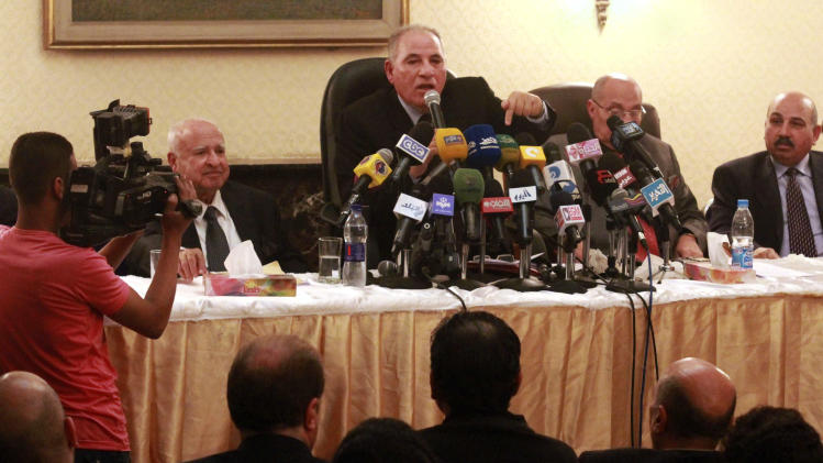 In this Sunday, Dec. 2, 2012 photo, the head of the powerful Egypt Judges Club Ahmed el-Zind, center, speaks at a press conference announcing that judges will not oversee the Dec. 15, 2012 referendum to approve a contentious draft constitution in Cairo, Egypt. El-Zind's comments are the latest in a standoff between President Mohammed Morsi and the judiciary with most judges on strike following decrees Morsi issued last month that placed himself and the constitutional assembly above judicial oversight. (AP Photo/Ahmed Ramadan)