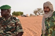 Malian deserters in a camp near Niamey on May 25, where some 500 hundred soldiers who fled from Mali&#39;s army after an offensive by Tuareg and Islamist rebels. The deserters were being guarded by Niger&#39;s army. A move by Mali&#39;s Tuareg and Islamist rebels to merge and declare a new state in the north has left the west African country closer to breakup -- two months after a fateful coup in the south