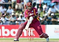 Kieron Pollard, pictured in action in June 2012, hit a patient half-century. West Indies beat New Zealand by 24 runs on Saturday to win the fourth one-day international and take the series 3-1